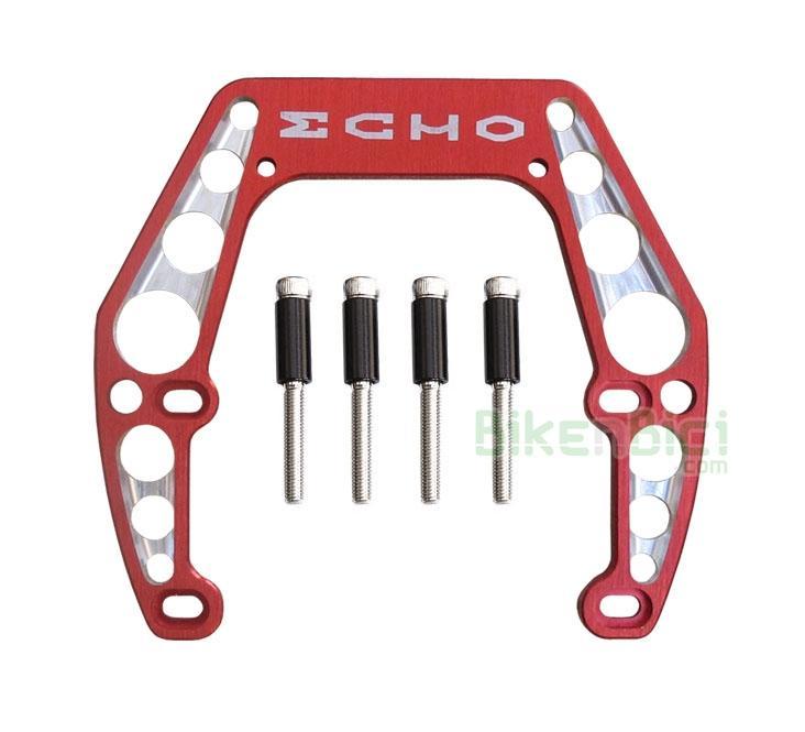 Frenos Trial GORILA ECHO 4 TORNILLOS Biketrial aluminio rojo - Gorila potenciador de frenada de la marca Echo para bicicletas de Trial y Biketrial que usan sistema de freno hidráulico de llanta, tipo Magura HS33. Fabricado en aluminio 7075-T6, se caracteriza por anclarse a los 4 tornillos del freno, aportando una gran rigidez sobretodo para la rueda trasera. Medida para cuadros de 92 a 105 mm de ancho entre soportes de freno. 109 gramos de peso (tornillos y casquillos incluidos).