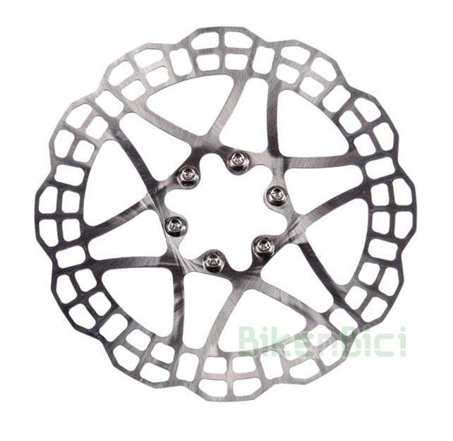 Frenos Trial DISCO HOPE TRIAL ZONE V2 2106 160mm Biketrial - Disco de freno original Hope Trial Zone, modelo V2, para bicicletas de trial y Biketrial. Medida de 160mm. Acero inoxidable Aisi-410. Compatible con todos los sistema de freno de disco del mercado. Anclaje al buje standard internacional de 6 tornillos. Incluye tornillería para fijación al buje. 95 gramos de peso (sin tornillos).