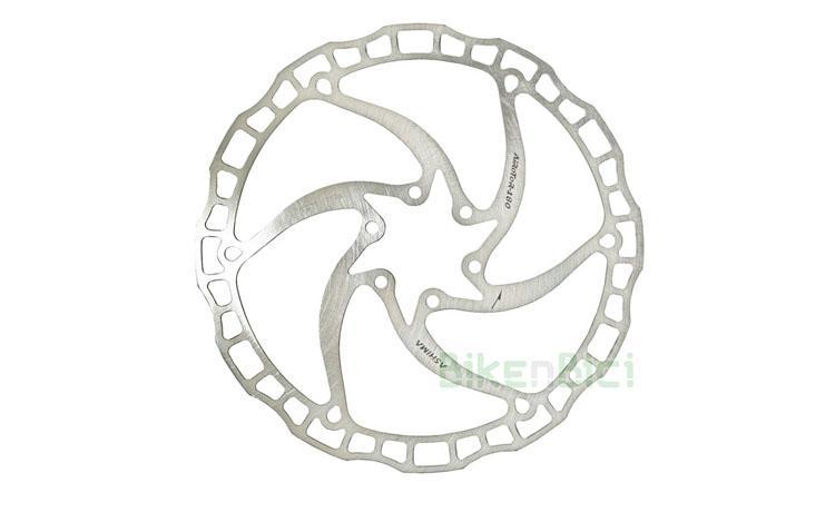 Frenos Trial DISCO ASHIMA ARO 08 160mm Biketrial - Disco de freno de la marca Ashima, modelo Aro 08. Acero inoxidable de alta calidad con un grip excepcional. 160mm de diámetro. 1.8mm de grosor. Para freno delantero y trasero. Sistema internacional de 6 tornillos (ISO). Incluye 6 tornillos tipo Torx M6x10. 86 gramos.