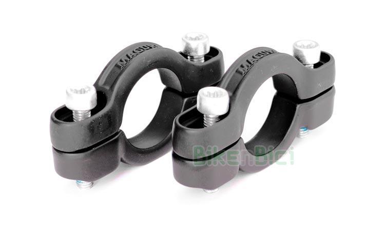 SOPORTES BOMBIN HIDRAULICO TRIAL MAGURA - Pareja de soportes para frenos Magura hidráulicos de llanta HS33, HS22 y HS11. El kit consta de una pareja de soportes para freno delantero o trasero y los 4 tornillos Torx M5x25 para fijarlos al chasis u horquilla. Fabricados en aluminio y acabados en color negro satinado. 68 gramos de peso.